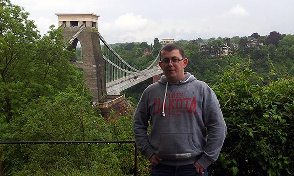 Chris Burn standing in front of Clifton Suspension Bridge